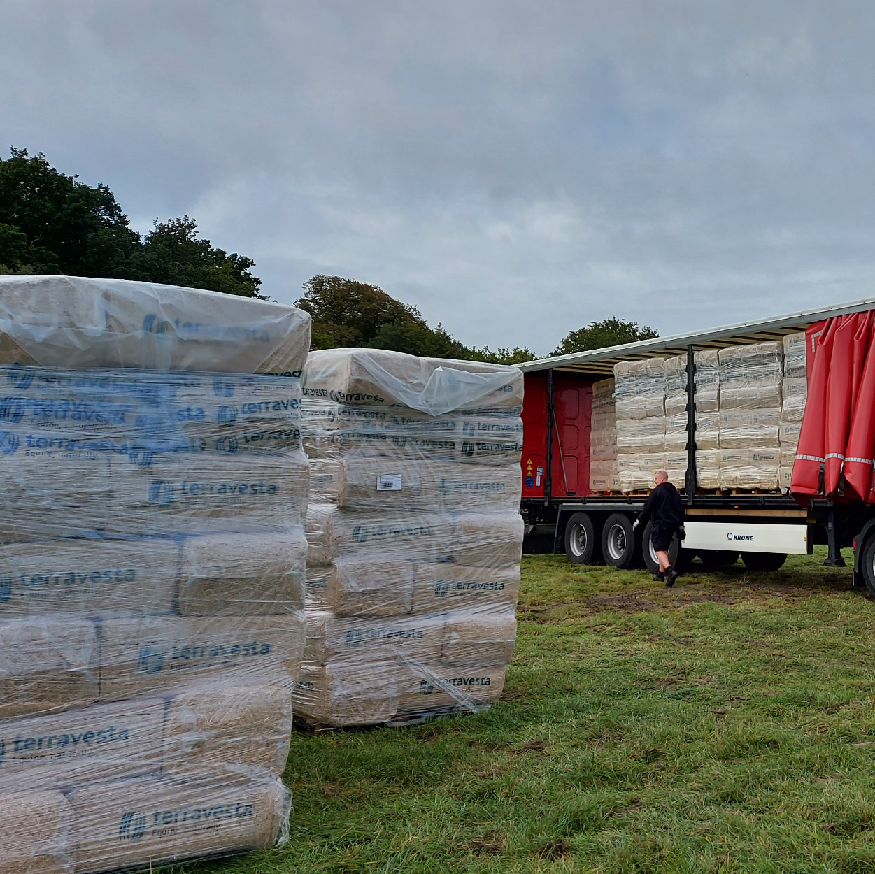 Pallets of horse bedding being unloaded